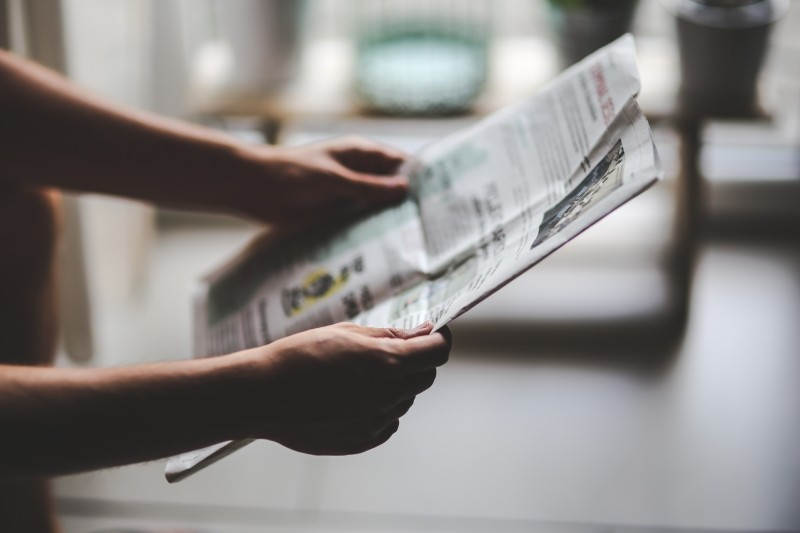 man-boy-male-read-reading-newspaper-hands