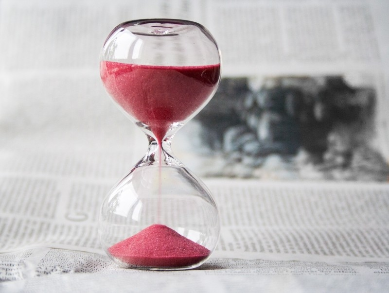 hourglass-on-newspaper
